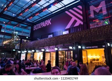 LONDON, UNITED KINGDOM - CIRCA MAY, 2018: People having fun inside Boxpark pop-up food market in East Croydon.