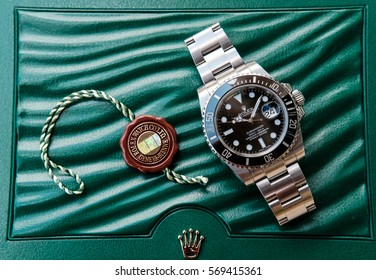 LONDON, UNITED KINGDOM - CIRCA MAY 2016: New Rolex Submariner divers watch shown with the cyclops window for the date as well as the new, ceramic bezel, as seen in its presentation case.