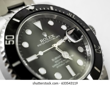LONDON, UNITED KINGDOM - CIRCA MAY 2017: Detailed view of the intricate face of a Swiss manufactured automatic divers watch, showing a shallow depth of field, highlighting the manufacturers logo.