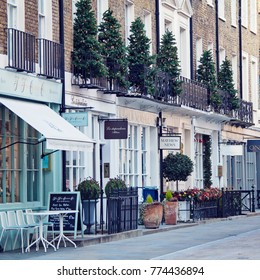 LONDON, UNITED KINGDOM - DECEMBER 12th, 2017:Street in Belgravia is decorated for Christmas. Belgravia is defined by elegant townhouse residences and is one of the wealthiest districts in the world.