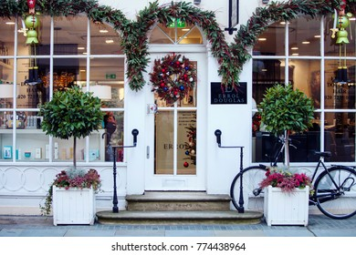 LONDON, UNITED KINGDOM - DECEMBER 12th, 2017:Shop in Belgravia is decorated for Christmas. Belgravia is defined by elegant townhouse residences and is one of the wealthiest districts in the world.