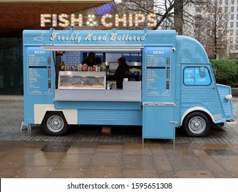 London, United Kingdom, December 21, 2019. Blue fish and chips van on London Southbank near Tate Modern. Neon sign, rainy day. London, United Kingdom, December 21, 2019
