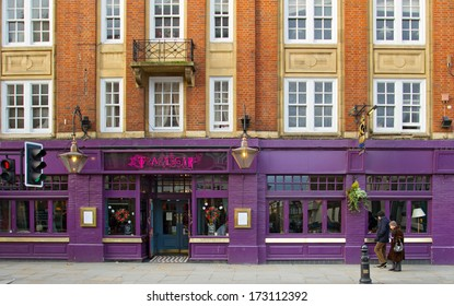 LONDON, UNITED KINGDOM - DECEMBER 25, 2011: People passing by Trafalgar pub on Kings Road in Chelsea. It serves an extensive range of continental beer, and wines from around the world.