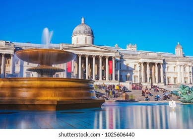 LONDON, UNITED KINGDOM - FEBRUARY 07: View of the famous Natonal Gallery museum with Trafalgar Square fountain on February 07, 2018 in London