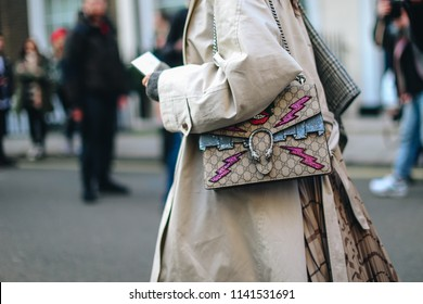 LONDON, United Kingdom- February 16 2018: Lady on the street during the London Fashion Week with a Gucci Handbag