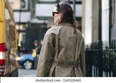 LONDON, United Kingdom- February 16 2018: Lady on the street during the London Fashion Week wearing beige Dior Jacket
