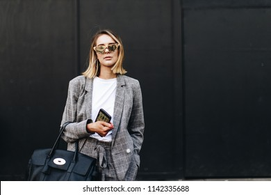 LONDON, United Kingdom- February 16 2018: Lady on the street during the London Fashion Week wearing grey Blazer and Sunglasses