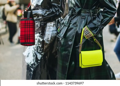 LONDON, United Kingdom- February 16 2018: Lady on the street during the London Fashion Week with a Burberry Handbag