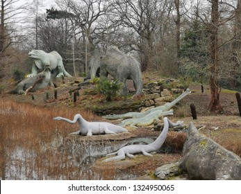 London, United Kingdom - February 16, 2019:  The Crystal Palace Dinosaurs: sculptures of dinosaurs and other extinct animals,  unveiled in 1854 as the first dinosaur sculptures in the world