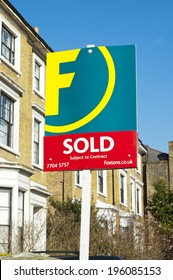 LONDON, UNITED KINGDOM - FEBRUARY 16, 2014: Foxtons Group plc Sold Sign Foxtons Group plc in London on February 16, 2014, UK. British estate agency company dealing with both lettings and sales.