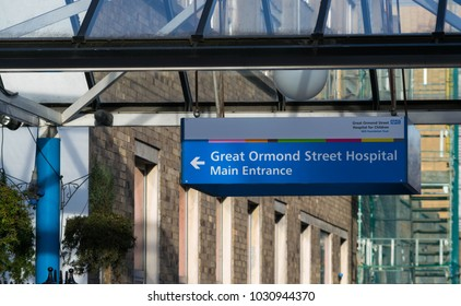 London, United Kingdom, February 17, 2018 : The front entrance of Great Ormond Street Hospital for Children in Bloomsbury with an information sign in the foreground