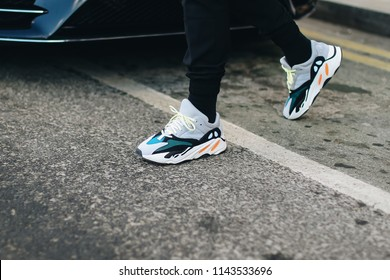 LONDON, United Kingdom- February 18 2018: Man on the street during the London Fashion Week wearing ADIDAS OG YEEZY WAVE RUNNER 700