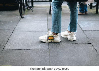 LONDON, United Kingdom- February 19 2018: Man on the street during the London Fashion Week wearing Gucci Sneaker