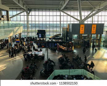 London / United Kingdom — February 21, 2018: passengers at gates in the boarding area of terminal 5 of London Heathrow Airport, the busiest airport in Europe