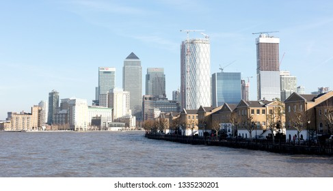 London, United Kingdom - February 21, 2019: London skyline buildings in Canary Warf, view from the Thames