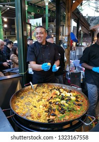 London, United Kingdom - February 24, 2019: Borough Market, one of the oldest, largest, and the most popular food markets in Southwark, London. Large paella