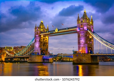 London, The United Kingdom of Great Britain: Night view of Bridge Tower after sunset. A combined bascule and suspension bridge which crosses the River Thames and has become an iconic symbol of London