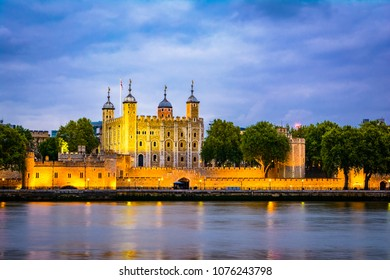 London, The United Kingdom of Great Britain: Night view of the Tower of London, UK, over the Thames river at night