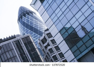 """LONDON, UNITED KINGDOM - JAN 17: the exterior of 30 St Mary Axe (the """"Gherkin"""" ) on Jan 17 2009 in London, United Kingdom. The Gherkin was completed in 2003 and stands 180 meters tall."""