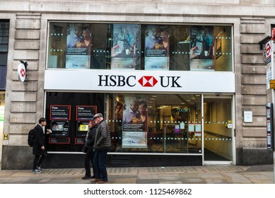 London, United Kingdom - January 1, 2017: Bank branch and ATM of HSBC Bank with people around in London, England, United Kingdom