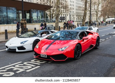 London, United Kingdom - January 1, 2017: Parade of Lamborghini Aventador on a street with people around in London, England, United Kingdom