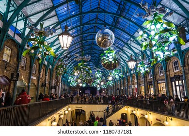 London, United Kingdom - January 1, 2018: Covent Garden, shopping center with stores and restaurants, with Christmas decoration and people around in London, England, United Kingdom
