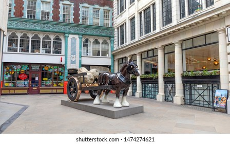 LONDON, UNITED KINGDOM - JANUARY 1: Perceval sculpture in Cullum Street on January 1, 2019 in London. Sarah Lucas' sculpture Perceval is a life-size bronze horse and cart.