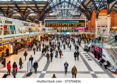 LONDON, UNITED KINGDOM - JANUARY 12, 2016: People at Liverpool Street station - opened in 1874 it is third busiest and one of the main railway stations in UK, with connection to London Underground.