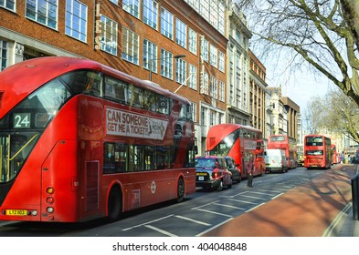 LONDON, UNITED KINGDOM - JANUARY 19: Traffic with taxi and traditional public double-decker busses in old and new style, on January 19, 2016 in London, England
