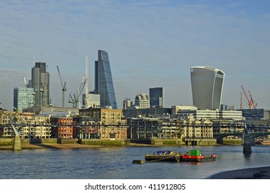 LONDON, UNITED KINGDOM - JANUARY 19: Millenniums bridge and sky srapers, B42 tower, Cheese grater and Sky garden building, on January 19, 2016 in London,. England