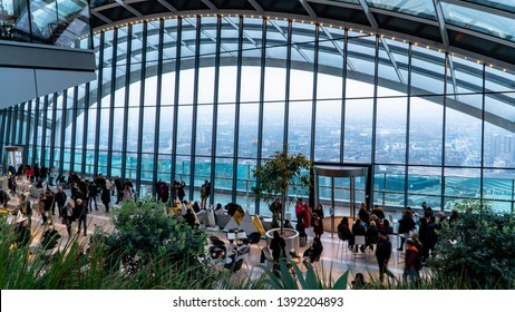 London, United Kingdom - January 2019: Sky Garden in London with tourists and London skyline