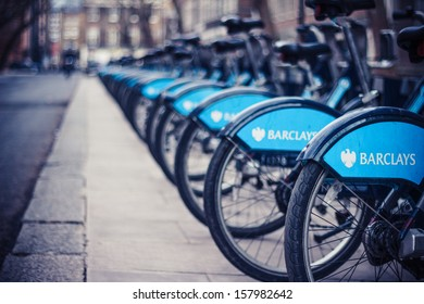 London, United Kingdom - January 25, 2013: Long row of Barclays bikes parked at rental station in London during the winter of 2013