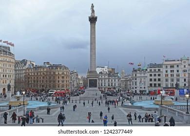London, United Kingdom - January 27, 2013: Lot of Tourists at Trafalgar Square Winter in London, United Kingdom.