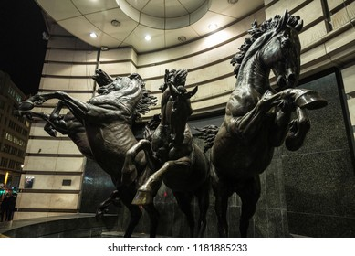 London, United Kingdom - January 3, 2018: The Four Bronze Horses of Helios, is an outdoor bronze sculpture by Rudy Weller in Piccadilly Circus at night in London, England, United Kingdom