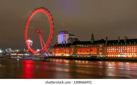 LONDON, UNITED KINGDOM - JANUARY 3: The London Eye at night on January 3, 2019 in London. The London Eye is Europe's tallest observation wheel and the most popular paid tourist attraction.