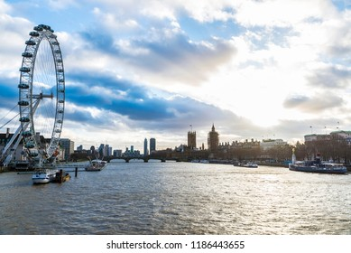 London, United Kingdom - January 4, 2018: Ferris wheel called The London Eye with boats moored on the River Thames in London, England, United Kingdom