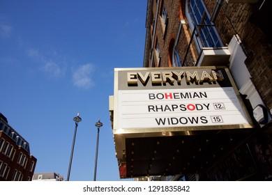 London, United Kingdom - January 6 2019: Exterior of Everyman Cinema Showing Bohemian Rhapsody And Widows Against Blue Sky With Copy Space
