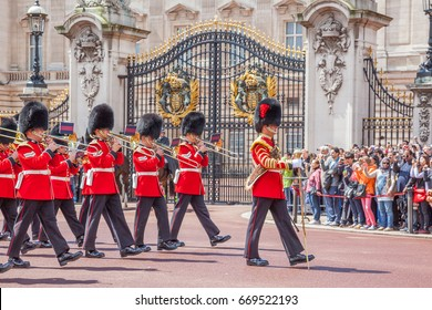 LONDON, UNITED KINGDOM - JULY 11, 2012: The band of the Grenadier Guards, led by a Drum Major of the Coldstream Guards, marches past Buckingham Palace during the Changing of the Guard ceremony.