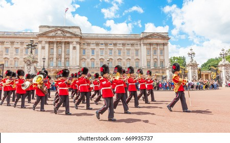 LONDON, UNITED KINGDOM - JULY 11, 2012: The band of the Coldstream Guards marches in front of Buckingham Palace during the Changing of the Guard ceremony.