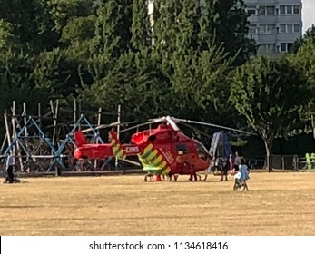 London, United Kingdom - July 15, 2018: Red London Air Ambulance land on King George Park in Wandsworth Town area.