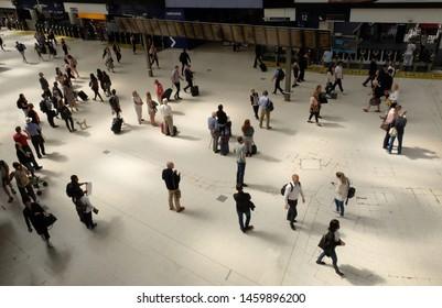 London, United Kingdom: July 1st 2019 - Passengers at Waterloo Railway Station