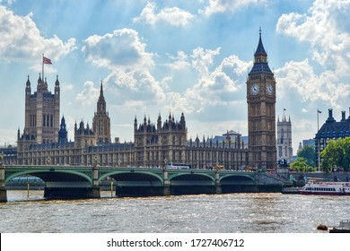London, United Kingdom - July 22, 2014. Houses of Parliament (Palace of Westminster) with a high clock tower - Big Ben. Westminster Bridge, view of the neo-Gothic House of Lords.