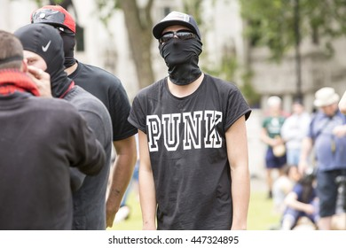 London, United Kingdom - July 4, 2016: Anarchist Demonstration in Parliament Square. A small group of Anarchists protested in Parliament Square against the Conservative government.