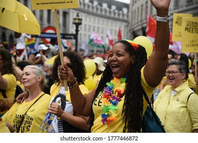 London, United Kingdom, July 6 2019: Happy lgbt people and supporters wearing colourful costumes with rainbow colors parading at the famous Pride Parade on the 6th of July at London, UK.