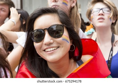 London, United Kingdom - July 8, 2017: Spectators at the London Pride March 2017. The path of the parade was lined with supporters many who came dressed for the occasion.