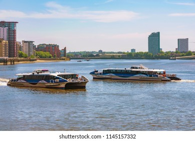 LONDON, UNITED KINGDOM - JUNE 06: View of Thames Clippers river bus boats, a popular form of transport along the River Thames on June 06, 2018 in London