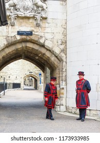 LONDON, UNITED KINGDOM - JUNE 09, 2013: Beefeaters near walls of the Tower of London. Beefeaters or Yeomen Warders, ceremonial guards of the Tower of London, United Kingdom