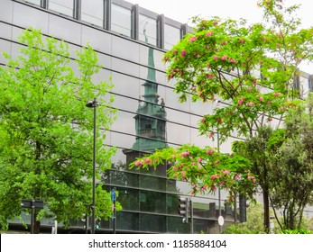 LONDON, UNITED KINGDOM - JUNE 09, 2013: Reflection of ancient church in glasses of the modern building. Church All Hallows by the Tower, London, United Kingdom.