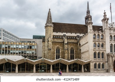 LONDON, UNITED KINGDOM - JUNE 1, 2013: Street scene in the central London with Guildhall (1440, ceremonial and administrative centre of City of London).