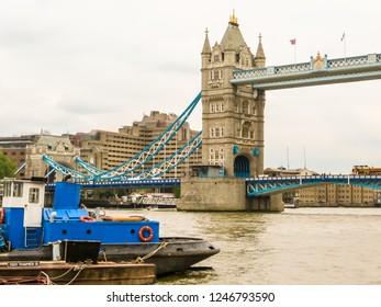 LONDON, UNITED KINGDOM - JUNE 10, 2013: Tower Bridge, iconic victorian bridge through the Thames River. London, United Kingdom